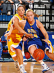 Morgan Meier drives around the defense of Jill Young, both of South Dakota State, during Midnight Madness Minus Two Friday evening at Frost Arena on the campus of South Dakota State University in Brookings, SD. (Photo By Ty Carlson/South Dakota State Sports Information)