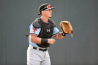 Catcher Yohel Pozo (3) of the Hickory Crawdads warms up before a game against the Greenville Drive on Monday, August 20, 2018, at Fluor Field at the West End in Greenville, South Carolina. Hickory won, 11-2. (Tom Priddy/Four Seam Images)