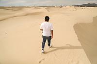 A man walks sand dunes of the Samalayuca Desert, Chihuahua Mexico. 52 km south of Ciudad Juárez in the middle of the desert area known as the Médanos de Samalayuca. This tourist and travel destination belongs to the Municipality of Ciudad Juárez in northern Mexico.<br /> (Photo: Luis Gutierrez / NortePhoto)<br /> <br /> un hombre camina dunas de arena del desierto de Samalayuca, Chihuahua Mexico. A 52 km al sur de Ciudad Juárez en medio de la zona desértica conocida como los Médanos de Samalayuca. Este destino turístico y de viajes pertenece al Municipio de Ciudad Juárez en el norte de Mexico. <br /> (Foto: LuisGutierrez/NortePhoto)