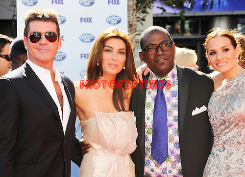 Simon Cowell, Mezhgan Hussainy, Randy Jackson and Kara DioGuardi at the 2010 American Idol Finale at Nokia Theatre in Los Angeles, May 26th 2010...Photo by Chris Walter/Photofeatures