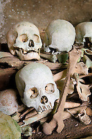 Rantepao, Tana Toraja, Sulawesi, Indonesia, October 2010. Skulls and bones in the cave graves of Tampangallo. When a Torajan dies in Toraja land, family members of the deceased are required to hold a series of funeral ceremonies that usually last for several days before the deceased is brought to a funeral site for burial. The Toraja people live a traditional life in the forested mountains of South Sulawesi.  Photo by Frits Meyst/Adventure4ever.com