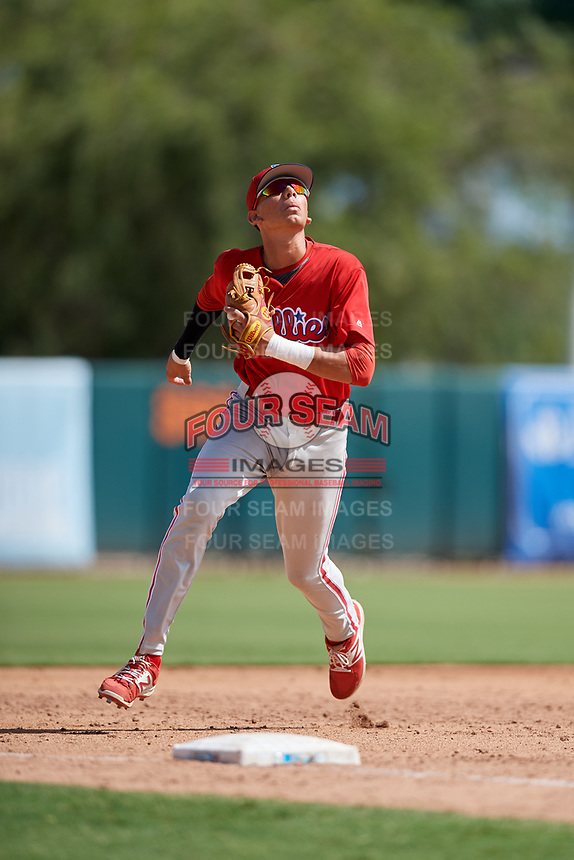 Philadelphia Phillies Juan Herrera (22) tracks a pop up during a Florida Instructional League game against the Baltimore Orioles on October 4, 2018 at Ed Smith Stadium in Sarasota, Florida.  (Mike Janes/Four Seam Images)