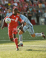 12 September 2009:  Toronto FC forward O'Brian White #17 chases down a ball while Colorado Rapids defender Kosuke Kimura #27 gives chase during MLS action at BMO Field Toronto in a game between Colorado Rapids and Toronto FC. .Toronto FC won 3-2..