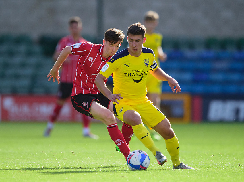 Oxford United's Cameron Brannagan under pressure from Lincoln City's Conor McGrandles<br /> <br /> Photographer Andrew Vaughan/CameraSport<br /> <br /> The EFL Sky Bet League One - Saturday 12th September  2020 - Lincoln City v Oxford United - LNER Stadium - Lincoln<br /> <br /> World Copyright © 2020 CameraSport. All rights reserved. 43 Linden Ave. Countesthorpe. Leicester. England. LE8 5PG - Tel: +44 (0) 116 277 4147 - admin@camerasport.com - www.camerasport.com - Lincoln City v Oxford United