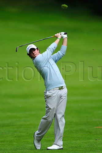 3rd September 2009 - Rory Mcilroy (NIR) hits a shot off the fairway during first round play at the Omega European Masters in Crans Montana, Switzerland.Photo: John Middlebrook/Actionplus. UK Licenses Only.