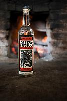 A bottle of Alipus. Felix Garcia a Maestro Mezcalero at his ranch and distillery in El Potrero, Oaxaca, Oaxaca, Mexico