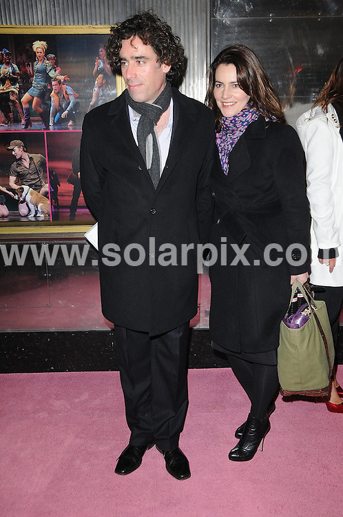 **ALL ROUND PICTURES FROM SOLARPIX.COM**.**WORLDWIDE SYNDICATION RIGHTS**.Legally Blonde - press night photocall at The Savoy Theatre, London, UK. 13 January 2010..This pic: Stephen Mangan and partner..JOB REF: 10461 MSR    DATE: 13_01_2010.**MUST CREDIT SOLARPIX.COM OR DOUBLE FEE WILL BE CHARGED**.**MUST NOTIFY SOLARPIX OF ONLINE USAGE**.**CALL US ON: +34 952 811 768 or LOW RATE FROM UK 0844 617 7637**