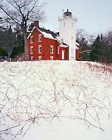Winter sunrise light on 40-Mile Point Aux Lighthouse on the shore of Lake Huron; Presque Isle County, MI