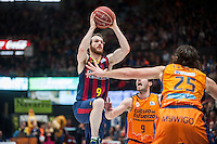 VALENCIA, SPAIN - MARCH 5: Sam Van Brossom, Loncar and M. Huertas during EURO CUP match between Valencia Basket Club and Bascelona F.C. Basket at Fonteta Stadium on March 22, 2015 in Valencia, Spain