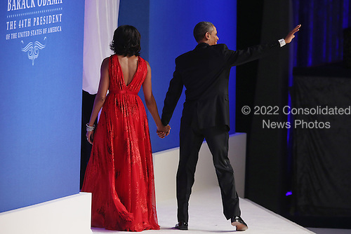 United States President Barack Obama and first lady Michelle Obama wave goodbye after attending the Commander-In-Chief Ball at the Walter Washington Convention Center January 21, 2013 in Washington, DC. President Obama started his second term by taking the Oath of Office earlier in the day during a ceremony on the West Front of the U.S. Capitol.  .Credit: Chip Somodevilla / Pool via CNP