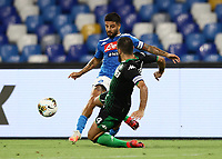25th July 2020; Stadio San Paolo, Naples, Campania, Italy; Serie A Football, Napoli versus Sassuolo; Lorenzo Insigne of Napoli challenged by Francesco Magnanelli US Sassuolo