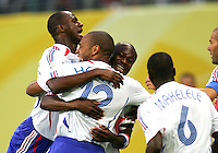 Thierry Henry (12) of France celebrates his goal with teammates.The Korea Republic and France played to a 1-1 tie in their FIFA World Cup Group G match at the Zentralstadion, Leipzig, Germany, June 18, 2006.