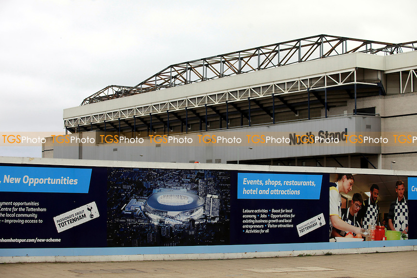 An artists impression of Tottenham's new 61,000 capacity stadium redevelopment is displayed on the outside walls surrounding the existing stadium  during Tottenham Hotspur FC Ground Redevelopment at White Hart Lane, London, England on 10/11/2015