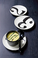 Served in elegant black and white china a dish of asparagus and tarragon en cocotte