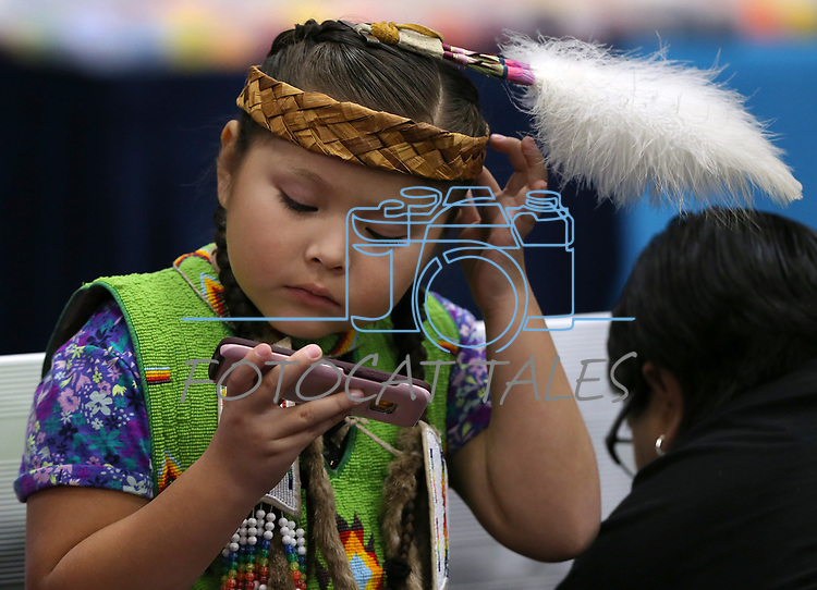 Sophia Scabbyrobe, 6, watches a movie before the start of the La Ka Lel Be powwow in Carson City, Nev., on Friday, Oct. 27, 2017. <br />Photo by Cathleen Allison/Nevada Momentum