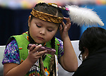 Sophia Scabbyrobe, 6, watches a movie before the start of the La Ka Lel Be powwow in Carson City, Nev., on Friday, Oct. 27, 2017. <br />