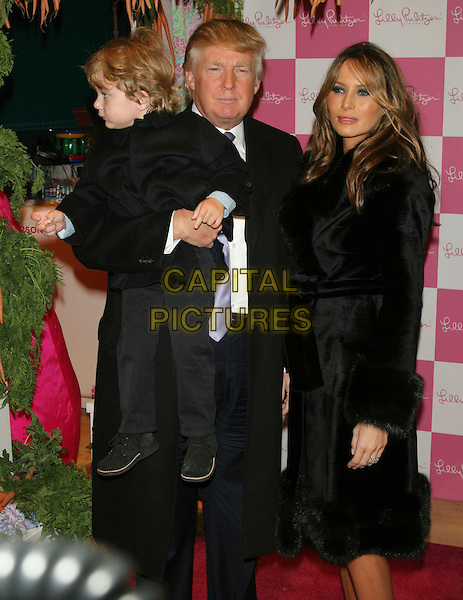 DONALD TRUMP, son BARRON & MELANIA TRUMP.17th Annual Bunny Hop, an evening of entertainment for children & their families, to benefit the Memorial Sloan-Kettering Cancer Center's Dept of Pediatrics, at FAO Schwarz (toy store) New York, NY, USA, . March 11, 2008..half length son  child kid husband wife family.CAP/LNC/TOM.?LNC/Capital Pictures