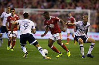 Tendayi Darikwa of Nottingham Forest goes between Lee Gregory and George Saville of Millwall during the Sky Bet Championship match between Nottingham Forest and Millwall at the City Ground, Nottingham, England on 4 August 2017. Photo by James Williamson / PRiME Media Images.
