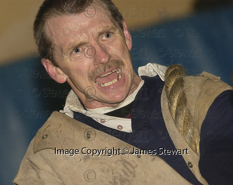 21/1/04          Copyright Pic : James Stewart.File Name : jspa08_tugowar.THE STRAIN SHOWS ON THE FACE OF GARY GILLESPIE AT THE SCOTTISH TUG O WAR TRAINING...... .Payment should be made to :-.James Stewart Photo Agency, 19 Carronlea Drive, Falkirk. FK2 8DN      Vat Reg No. 607 6932 25.Office     : +44 (0)1324 570906     .Mobile  : +44 (0)7721 416997.Fax         :  +44 (0)1324 570906.E-mail  :  jim@jspa.co.uk.If you require further information then contact Jim Stewart on any of the numbers above.........