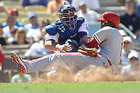 09/01/10 Los Angeles, CA: Philadelphia Phillies right fielder Domonic Brown #9 and Los Angeles Dodgers catcher Rod Barajas #28 during an MLB game played at Dodger Stadium between the Philadelphia Phillies and the Los Angeles Dodgers. The Phillies defeated the Dodgers 5-1.