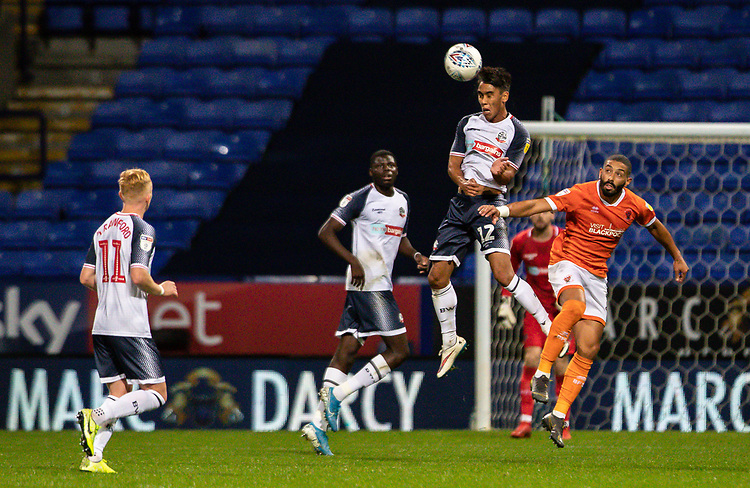 Bolton Wanderers' Adam Chicksen (2nd right) clears in defence<br /> <br /> Photographer Andrew Kearns/CameraSport<br /> <br /> The EFL Sky Bet League One - Bolton Wanderers v Blackpool - Monday 7th October 2019 - University of Bolton Stadium - Bolton<br /> <br /> World Copyright © 2019 CameraSport. All rights reserved. 43 Linden Ave. Countesthorpe. Leicester. England. LE8 5PG - Tel: +44 (0) 116 277 4147 - admin@camerasport.com - www.camerasport.com