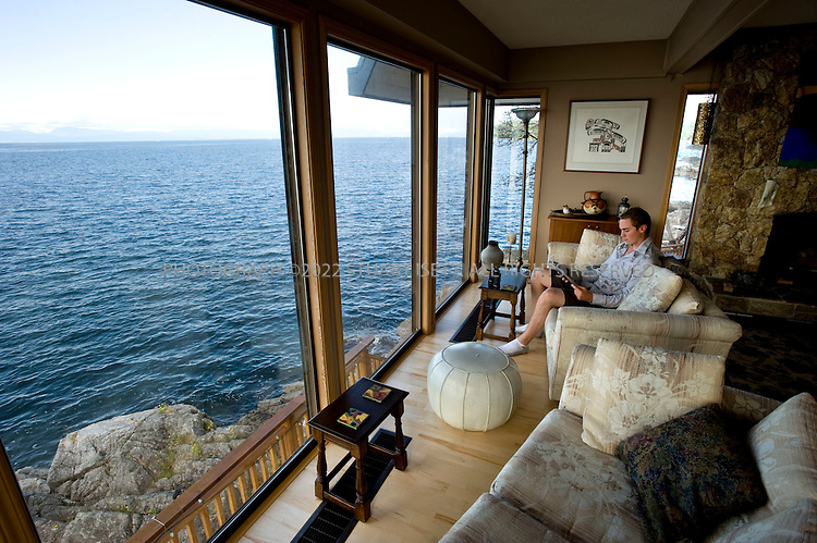 7/6/2008--Sechelt, British Columbia, Canada..The Four Winds Beach House and Spa, a B&B in Sechelt, B.C., is perched on a rocky point, jutting into the waters of Georgia Strait. Rooms in the high season run from CN$150-200..The rocky Sunshine Coast of British Columbia is just two hours northwest of Vancouver and can only be reached by ferry from Horseshoe Bay near Vancouver. Much of the coastline is accessible by boat only and protected as provincial parkland and visitors have an array of activities to choose from including hiking, kayaking, diving and sailing. Hotels, resorts and B&Bs offer a range of accommodation for travelers...©2008 Stuart Isett. All rights reserved.