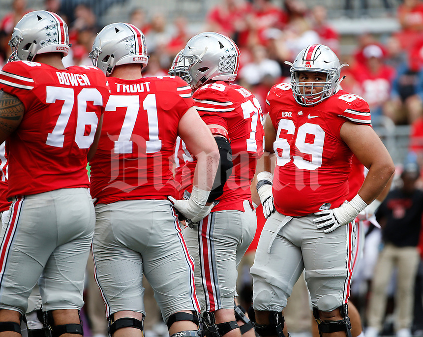 Ohio State Buckeyes offensive lineman Matthew Burrell (69) huddles with teammates during the NCAA football game against the Rutgers Scarlet Knights at Ohio Stadium in Columbus on Oct. 1, 2016. Ohio State won 58-0. (Adam Cairns / The Columbus Dispatch)