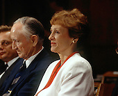 Joan Mondale, wife of former United States Vice President Walter Mondale, listens as her husband gives testimony before the U.S. Senate Foreign Relations Committee confirmation hearing on his nomination as U.S. Ambassador to Japan on July 28, 1993.  At left is former U.S. Senate Majority Leader and U.S. Ambassador to Japan Mike Mansfield. Mrs. Mondale passed away on February 3, 2014.<br /> Credit: Ron Sachs / CNP
