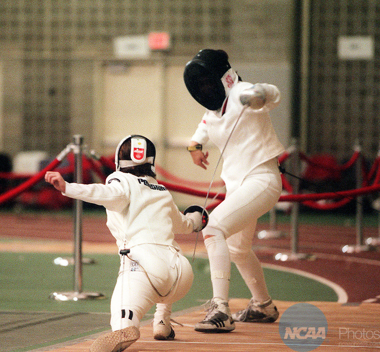 MAR 21 1999: Penn State's Stephanie Eim (left) lunges toward Stanford's Felicia Zimmerman (right) during the Women's Epee championship of the Men's and Women's Fencing Championship held at Brandeis Univesity in Waltham, MA. Zimmerman defeated Eim for the championship title. Bill Polo/NCAA Photos.