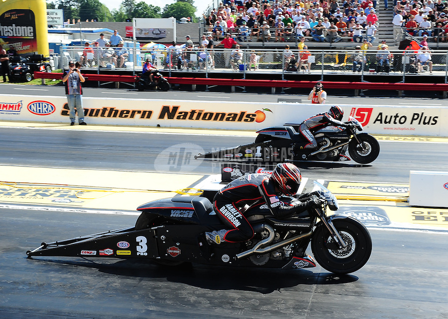 May 4, 2012; Commerce, GA, USA: NHRA pro stock motorcycle rider Andrew Hines (near Lane) races alongside Eddie Krawiec during qualifying for the Southern Nationals at Atlanta Dragway. Mandatory Credit: Mark J. Rebilas-