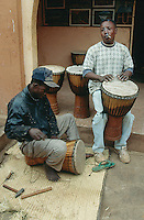 Mali. Bamako.Central market. Small shop sells handmade djembes. Two men are making new drums to be sold to musicians and tourists. © 1997 Didier Ruef