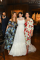 The bride wearing Dolce and Gabbana posing with two of her guests.