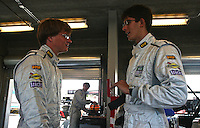 May 17, 2009: Drivers Jared Beyer, left, and Jordan Taylor talk at  the Verizon Festival of Speed Grand-Am Rolex Series race at Mazda Raceway at Laguna Seca  in Salinas, CA. (Photo by Brian Cleary/www.bcpix.com)