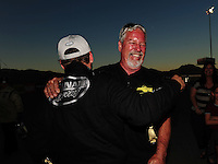 Oct. 30, 2011; Las Vegas, NV, USA: NHRA top fuel dragster driver Del Worsham (left) is congratulated by father Chuck Worsham after winning the Big O Tires Nationals at The Strip at Las Vegas Motor Speedway. Mandatory Credit: Mark J. Rebilas-