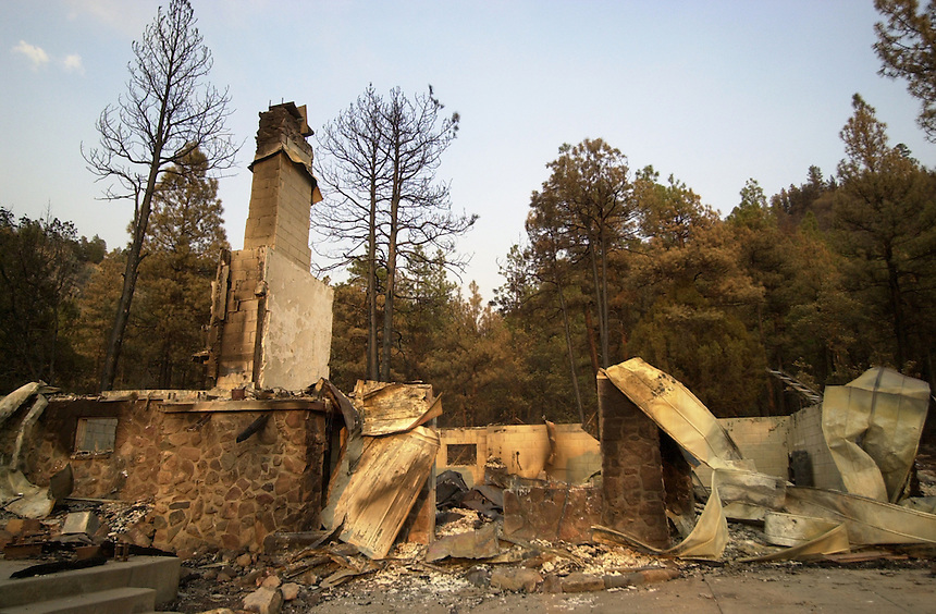 The remains of a home burned in the 2002 Missionary Ridge Fire north of Durango, Colorado in June, 2002.