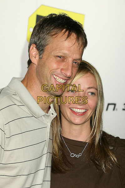 TONY HAWK & WIFE.Best Buy's Playstation 3 Launch Celebration and Block Party at Best Buy West Hollywood, West Hollywood, California, USA,16 November 2006..portrait headshot married husband couple.CAP/ADM/BP.©Byron Purvis/AdMedia/Capital Pictures.
