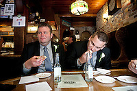 Married one hour ago, John Odum (L) and Dustin Endicott, from Birmingham, AL, eat hamburgers at Louis' Lunch hamburger joint in New Haven, CT, USA, 26 May 2009.