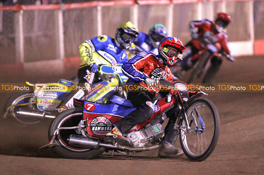 Henning Bager (Blue) of Lakeside leads Tobias Kroner (Yellow) and Kim Jansson (Green) of Ipswich and team colleague Chris Neath (Blue) in Heat 8 - Lakeside Hammers vs Ipswich Witches at The Arena Essex Raceway, Thurrock - 16/03/07 - MANDATORY CREDIT: Rob Newell/TGSPHOTO