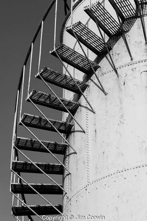 Gasoline storage tank with staircase along side creating patterns