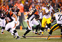 Tyler Eifert #85 of the Cincinnati Bengals runs with the ball after catching a pass against the Pittsburgh Steelers during the Wild Card playoff game at Paul Brown Stadium on January 9, 2016 in Cincinnati, Ohio. (Photo by Jared Wickerham/DKPittsburghSports)