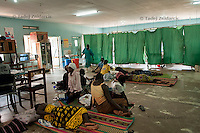 Expecting mothers lay on the floor of the labor ward of Arua Hospital, Uganda, waiting for delivery. There are not enough beds to go around.