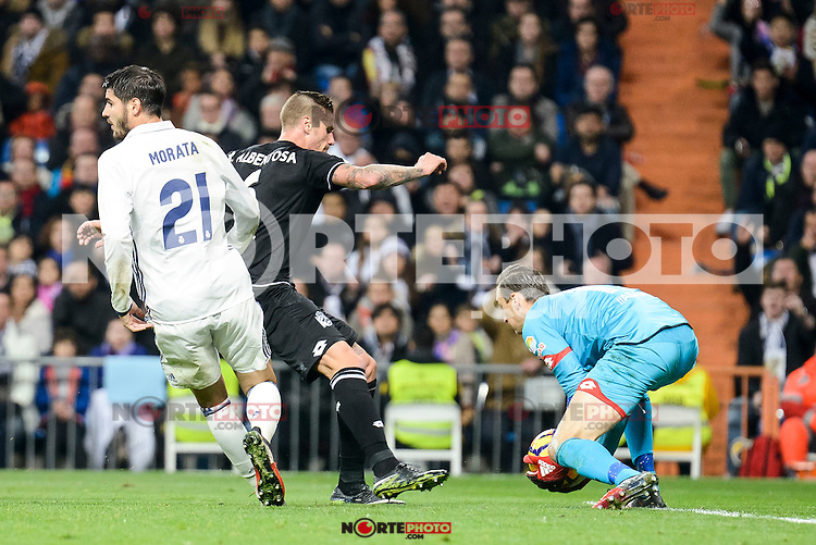 Real Madrid Alvaro Morata and Deportivo de la Coruña Tyton during La Liga match between Real Madrid and Deportivo de la Coruña at Santiago Bernabeu Stadium in Madrid, Spain. December 10, 2016. (ALTERPHOTOS/BorjaB.Hojas) /NORTEPHOTO.COM