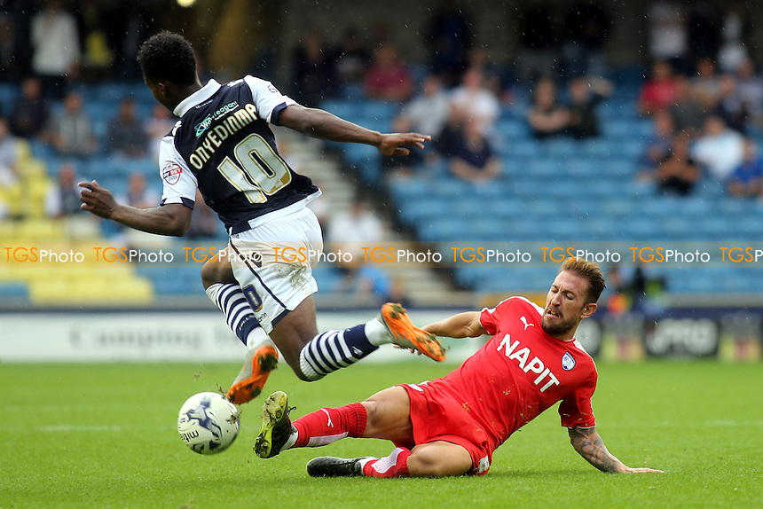 Fred Onyedinma of Millwall skips over a challenge from Chesterfield's Angel Martinez during Millwall vs Chesterfield, Sky Bet League 1 Football at The Den, London, England on 29/08/2015