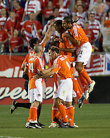 Houston Dynamo teammates Brian Ching (25), Eddie Robinson (2), Wade Barrett (24), and Brian Mullan (9) hoist Ricardo Clark (13) into the air as Dwayne De Rosario (14) jumps in after Clark's unassisted goal at Robertson Stadium in Houston, TX on Saturday May 6, 2006.  The Houston Dynamo defeated FC Dallas 4-3.