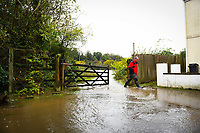 Flooding effected the villages of Aberdulais and Tonna in the Neath Valley after Storm Callum brought heavy rain and wind to the area cuasing the River Neath to reach bursting point.<br /> A man walks through a flooded footpath. Saturday 13 October 2018