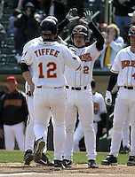 April 10, 2004:  Luis Rodriguez (2) and Terry Tiffee (12) of the Rochester Red Wings, Triple-A International League affiliate of the Minnesota Twins, celebrate Tiffee's home run during a game at Frontier Field in Rochester, NY.  Photo by:  Mike Janes/Four Seam Images