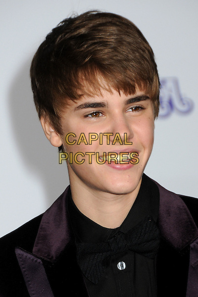 "JUSTIN BIEBER.""Justin Bieber: Never Say Never"" Los Angeles Premiere held at Nokia Theater L.A. Live, Los Angeles, California, USA, .8th February 2011..portrait headshot smiling black shirt smiling velvet jacket brown purple .CAP/ADM/BP.©Byron Purvis/AdMedia/Capital Pictures."