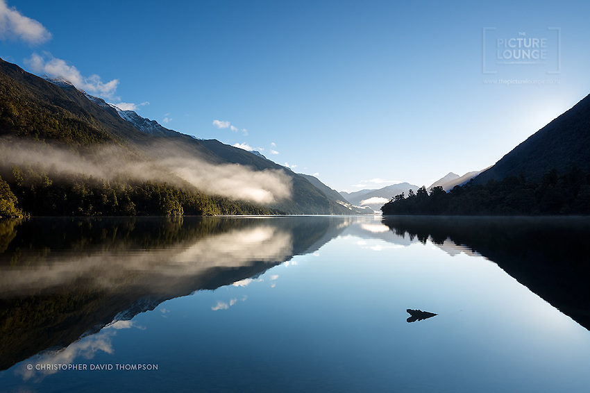 Views like this are exceptionally rare, and having them entirely to yourself just makes them all the more special - deep in the wilderness of the Hollyford Valley, photographer Christopher Thompson was in his element, enjoying the beautiful moments of this winter's dawn on Lake Alabaster in Fiordland.
