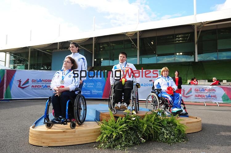 IPC European Athletics Championship 2014<br /> Swansea University<br /> <br /> Medal ceremony: Women's shot put F32/33.<br /> Gold medal Svetlana Krivenok (RUS)<br /> Silver medal Maria Stamatoula (GRE)<br /> Bronze medal: Anthi Liagkou (GRE)<br /> <br /> 23.08.14<br /> Chris Vaughan-SPORTINGWALES
