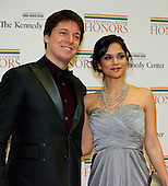 Joshua Bell and Larisa Martinez arrive for the formal Artist's Dinner honoring the recipients of the 2012 Kennedy Center Honors hosted by United States Secretary of State Hillary Rodham Clinton at the U.S. Department of State in Washington, D.C. on Saturday, December 1, 2012. The 2012 honorees are Buddy Guy, actor Dustin Hoffman, late-night host David Letterman, dancer Natalia Makarova, and the British rock band Led Zeppelin (Robert Plant, Jimmy Page, and John Paul Jones)..Credit: Ron Sachs / CNP